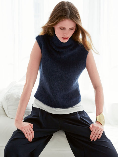 A pretty tank sweater in a luxe blend of linen and organic cotton. With a swingy shape, a slouchy turtleneck, and a sleeveless style that narrows at the shoulders. Relaxed fit. Cropped, A-line silhouette. Slouchy turtleneck. Sleeveless; bra-friendly. Linen/organic cotton.