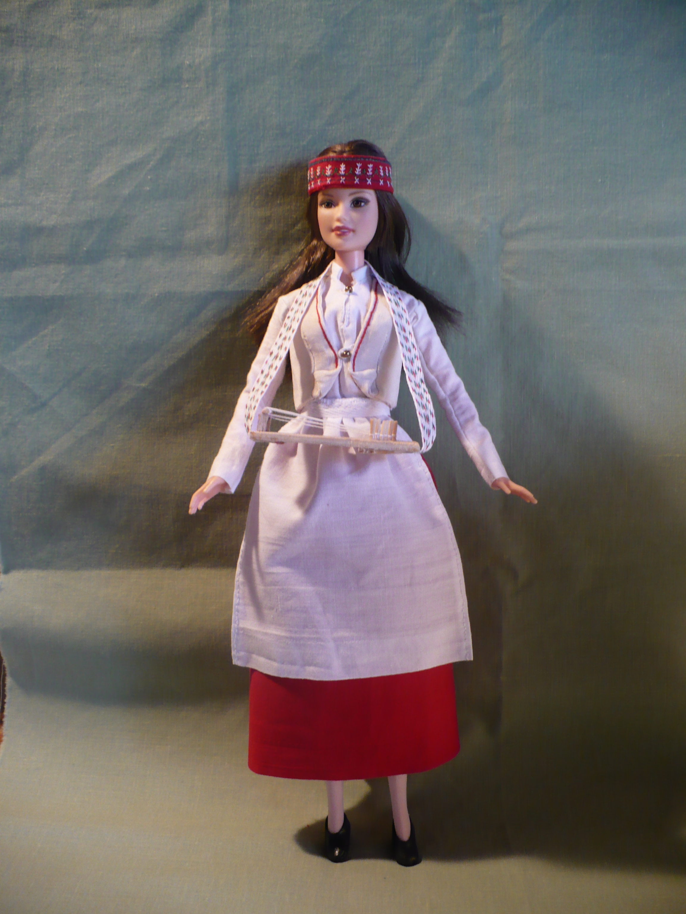 Latvian Woman With Dolls 43