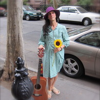 Cathy_with_flower_and_guitar_listing