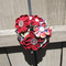 Red_flower_bouquet_in_fence_grid