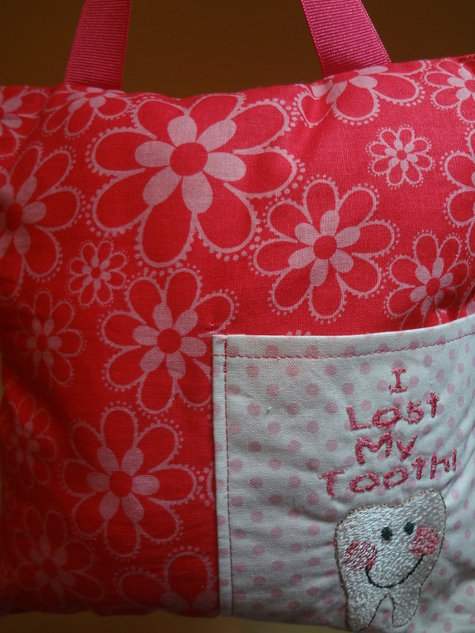 Pink_flower_and_tooth_pillow_large